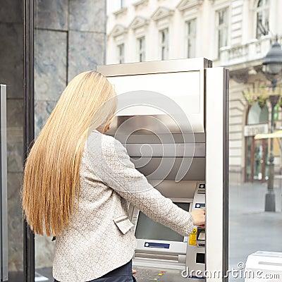 Woman use Bank ATM machine