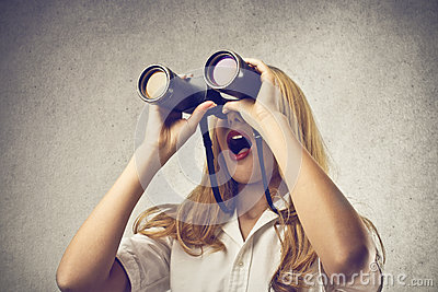 Woman using a binoculars