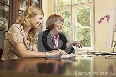 Woman Using Computer In Study Room