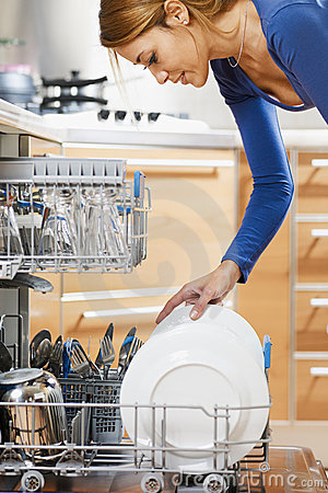 Free Woman Using Dishwasher Royalty Free Stock Photo - 12853215