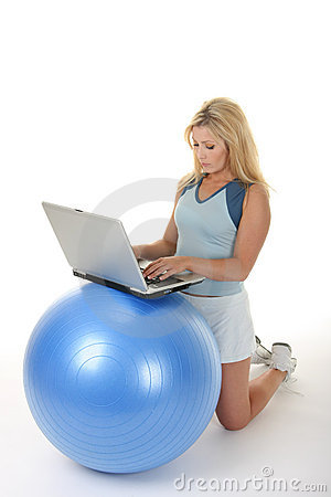 Woman Using Exercise Ball Desk