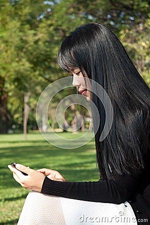 Woman using handheld.