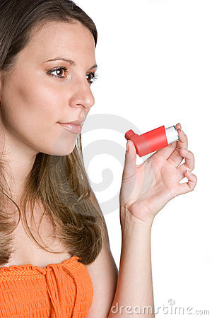 Woman Using Inhaler