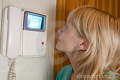 Woman using intercom
