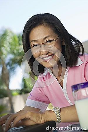Woman Using Laptop At The Backyard
