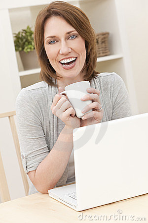 Woman Using Laptop Computer Drinking Tea Coffee