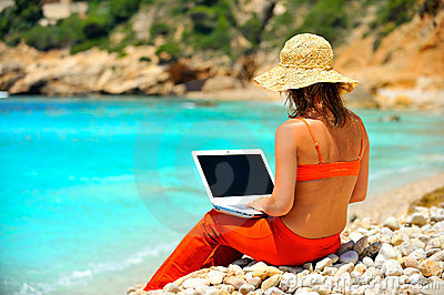 Woman using laptop outdoor