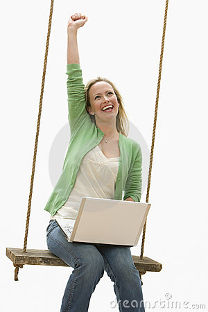 Woman Using Laptop on a Swing