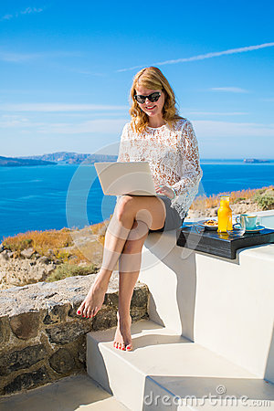 Free Woman Using Laptop While On Vacation In Mediterranean Stock Photography - 93053602