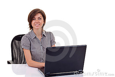 Woman using laptop at work desk