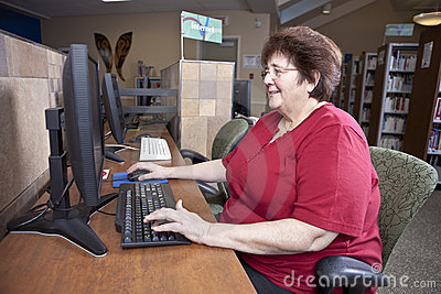 Woman using library computer