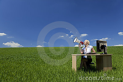 Woman Using Megaphone In A Field