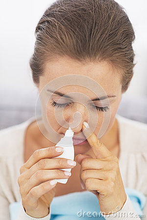 Woman using nasal drops