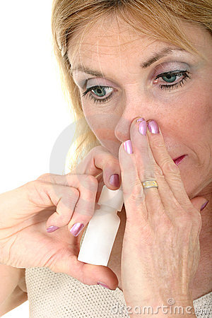Woman Using Nasal Spray with Hand
