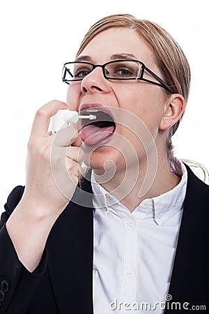 Woman using oral spray