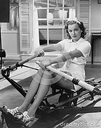 Free Woman Using Rowing Machine Stock Photos - 52003953