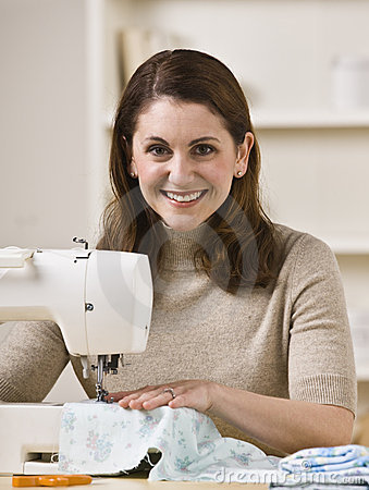 Woman Using Sewing Machine