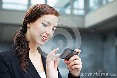 Woman using smartphone on the way