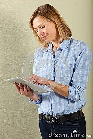 Woman using tablet computer in studio