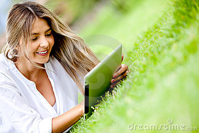 Woman using a tablet outdoors