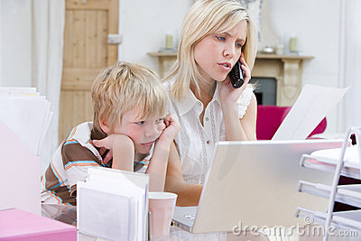Woman Using Telephone In Office With Laptop Stock Photos - Image: 5931113