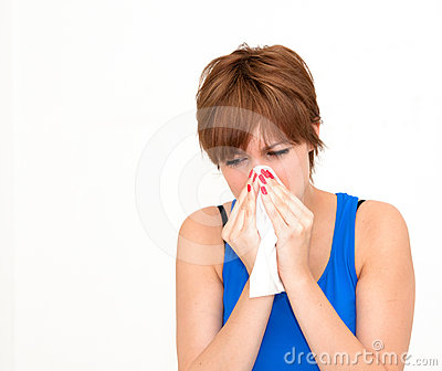 Woman using tissue