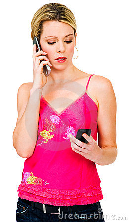 Woman using two mobile phones