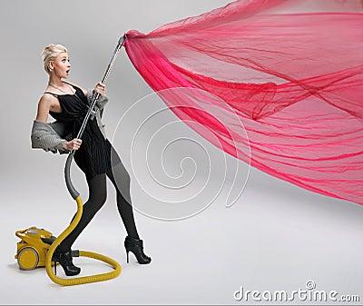Woman using vacuum cleaner.