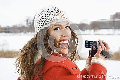 Woman using video camera.