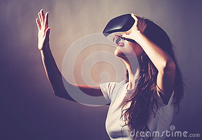 Woman using a virtual reality headset Stock Photo