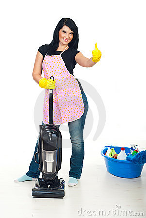 Woman with vacuum cleaner gives thumbs