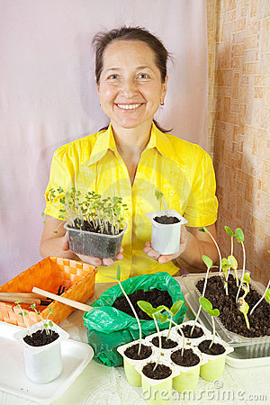 Woman with  various seedling