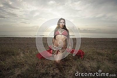 Woman with a veil on the beach
