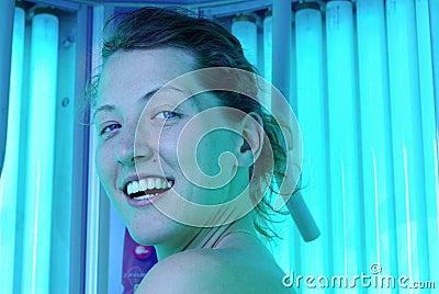Woman in vertical solarium