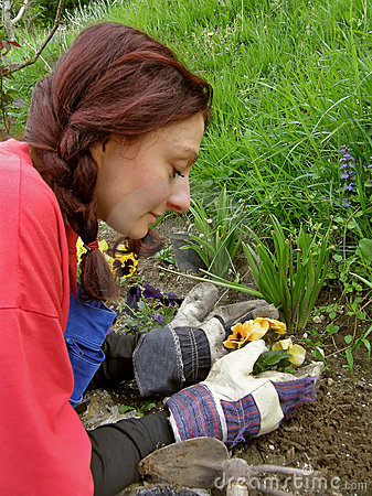 Woman with a view full of love flowers planted