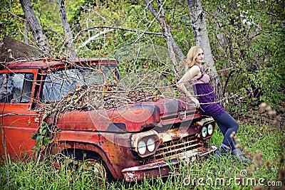 Woman on vinatge truck