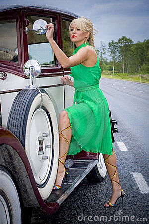 Woman and vintage car