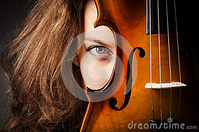Woman with violin in dark