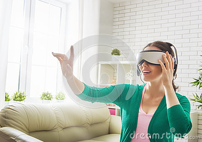 Woman in virtual reality glasses. Stock Photo