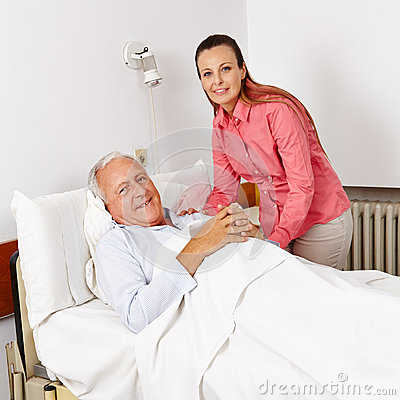 Smiling carer pushing an old man in a wheelchair stock photo image - Woman Visiting Old Man In Hospital Royalty Free Stock