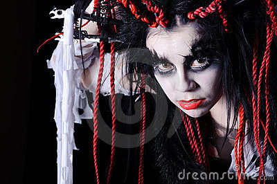 Woman with voodoo shaman make-up