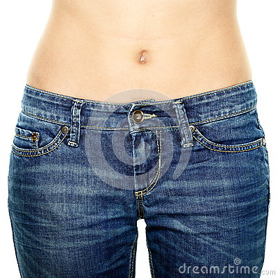 Woman waist wearing jeans. Weight loss stomach.