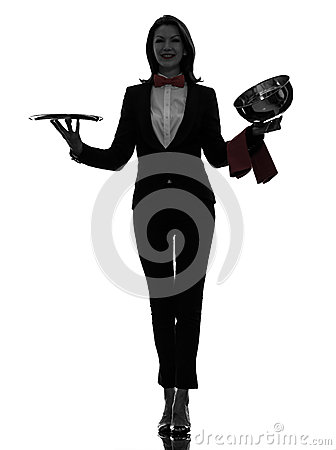 Woman waiter butler opening catering dome silhouette