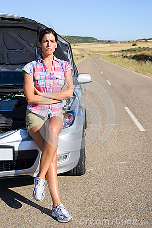 Woman waiting for car service help in roadhelp in road