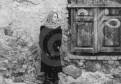 Woman waiting near the retro wall