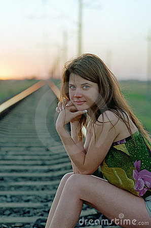 Woman waiting on railroad