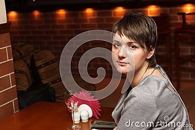 Woman waits a waiter