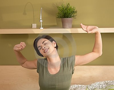 Woman waking up stretching
