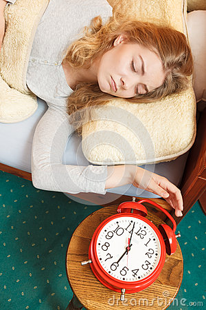 Free Woman Waking Up Turning Off Alarm Clock In Morning Stock Photo - 61198720