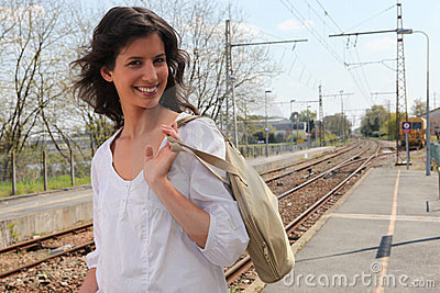 Woman walking along train platform